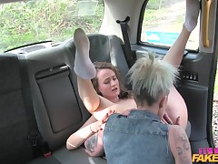female-on-female fake taxi driver munches passenger's wet crack